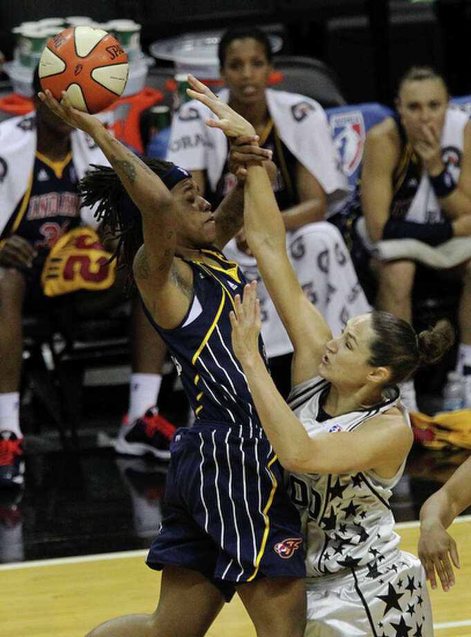 Silver Stars Ruth Riley (right) contends a shot against Indiana Fever's Shavonte Zellous (01) in the first half at the AT&T Center on Friday, August 20, 2010. The Stars defeated the Fever, 75-61. / San Antonio Express-News