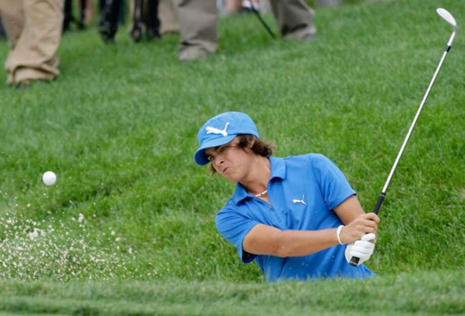 Rickie Fowler hits from the bunker en route to par on the par-3 eighth hole in the third round of the Memorial.