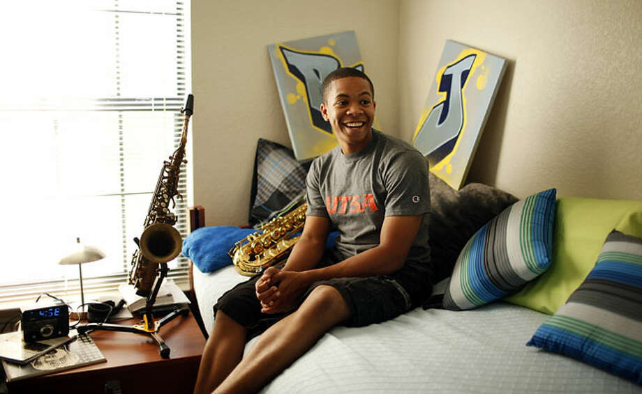 RJ Vaughn in his dorm room at UTSA. He's one of five college students from around the country who won a Wal-Mart shopping spree, online commercial and decorating help.