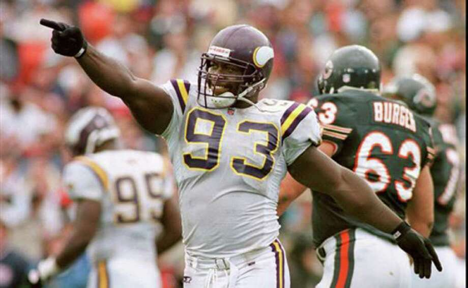 Minnesota Vikings defensive tackle John Randle, shown in a 1996 game with the Chicago Bears, had 137 career sacks, tied for sixth all-time.