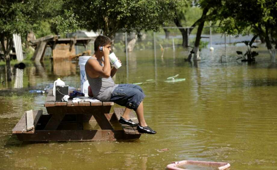 Pedro Incinia talks on his cell phone in the Hidalgo County town of Havana, where the Rio Grande has spread a mile past its banks.