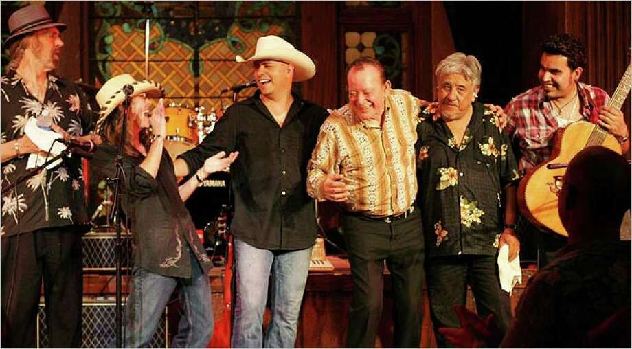 The Texas Tornados take a bow after their Casbeers show in June.