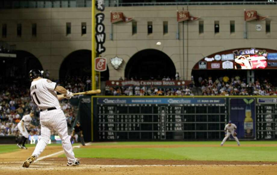 Houston's Lance Berkman hits a seventh-inning grand slam against Chicago at Minute Maid Park, his first since 2008.