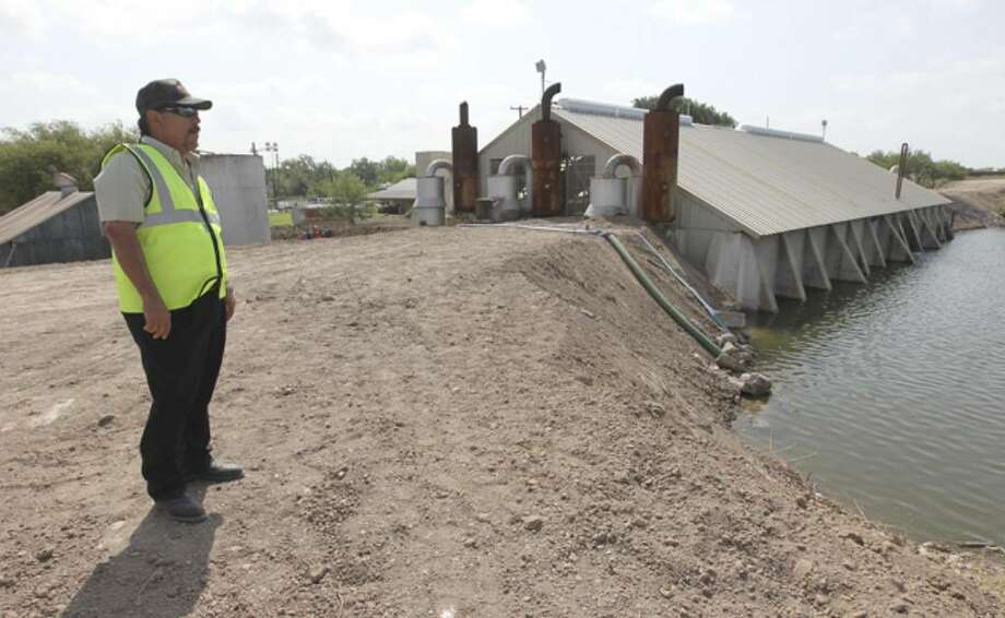 Richard Garza, superintendent of Edinburg Pump Station in Penitas, overlooks a newly reinforced levee as concerns of rising flood waters from the Rio Grande continue to be an issue along Texas border towns.