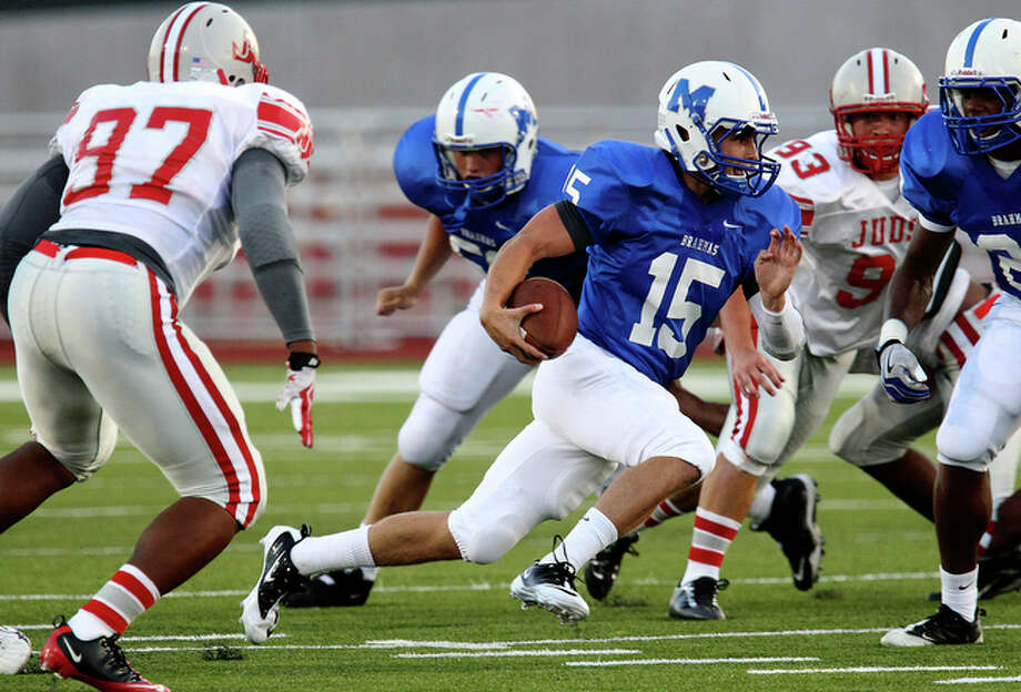 MacArthur quarterback Clinton Killough (15) finds room to run past Judson's Aarom Whalon (97) in the first half at Heroes Stadium on Friday, August 27, 2010. Kin Man Hui/kmhui@express-news.net / San Antonio Express-News