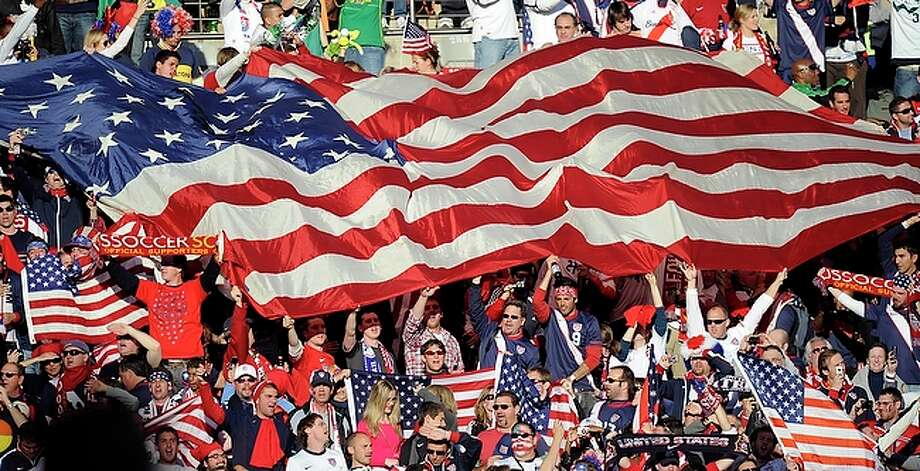 United States' fans wave their national flag during the World Cup group C soccer match between Slovenia and the United States at Ellis Park Stadium in Johannesburg, South Africa,. Landon Donovan and Michael Bradley scored in a furious second-half comeback, giving the United States a 2-2 tie against Slovenia on Friday that kept alive the Americans' chances of advancing in the World Cup. / AP
