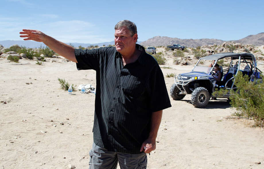 Randall Peterson shows where an off-road truck killed eight people, including his stepson, Zachary Freeman.