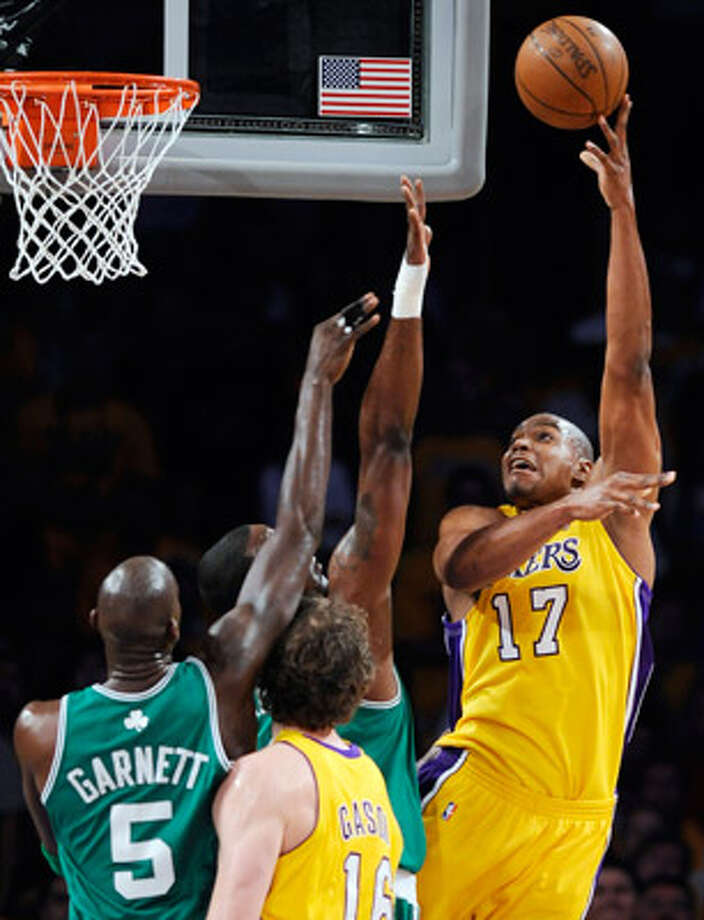 Los Angeles Lakers center Andrew Bynum shoots over Boston Celtics players as the Lakers' Pau Gasol watches during Game 1.