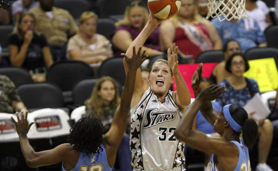 The Silver Stars' Jayne Appel shoots between Chicago's Epiphanny Prince (left) and Sylvia Fowles during Saturday's loss at the AT&T Center.