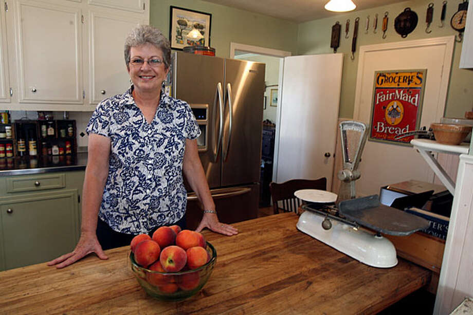 Ann Rhew's kitchen in her farmhouse features a $9 worktable island. Rhew operates Rhew Orchards with husband Frank; she runs Rhew Orchard House with daughter-in-law Judy.