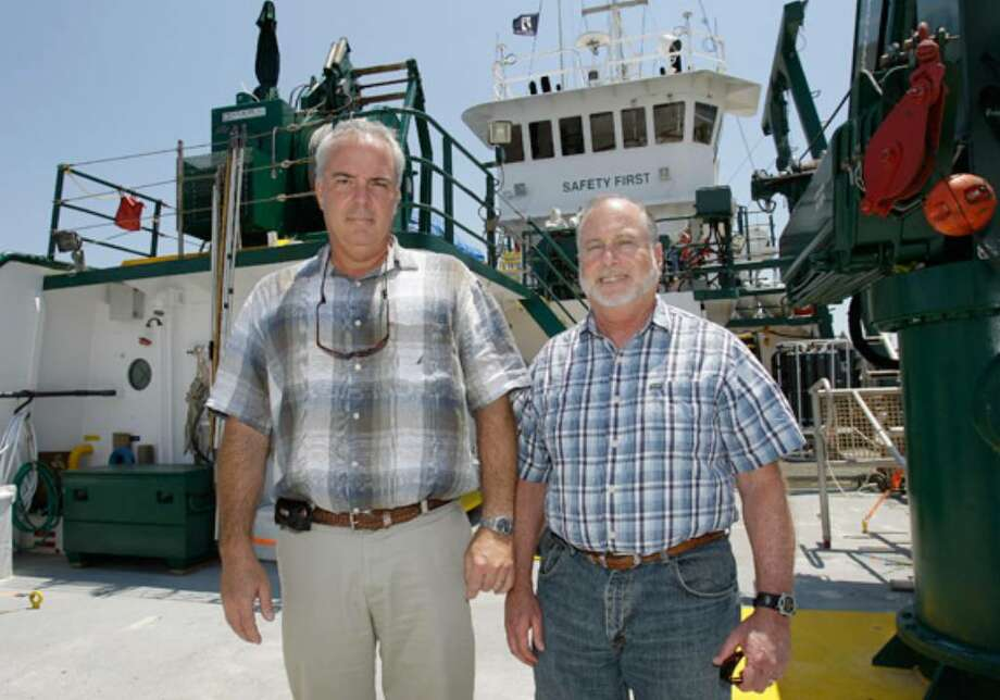 "University of South Florida College of Marine Science professors Ernst Peebles (left) and Bob Weisberg stand on the research ship ""Weatherbird II"" in St. Petersburg, Fla. Until about six weeks ago, the University of South Florida marine scientists occupying a World War II-era Army barracks near downtown St. Petersburg went about their research quietly. Then the BP oil rig exploded and sank, making them some of the most sought-after authorities on the planet. The growing disaster also has made USF and its findings the targets of BP executives' wrath, even as lower-level BP officials work side-by-side with the USF team to track the spreading spill."