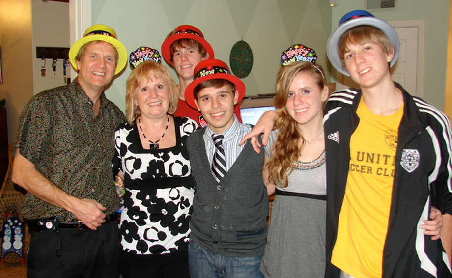 The Myers family of San Antonio with their latest exchange student, Carmine (center).