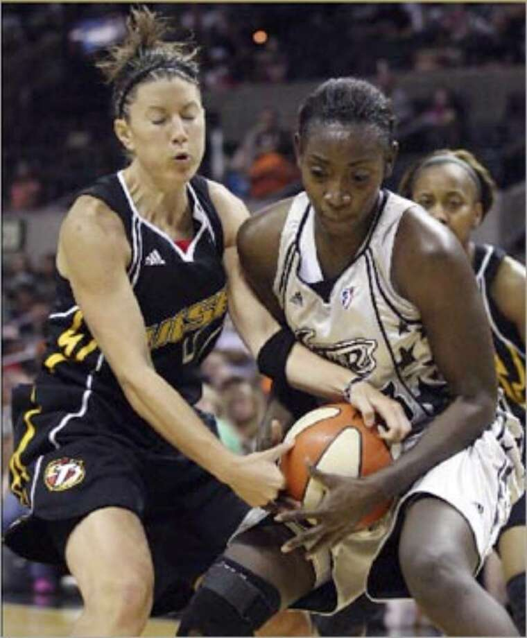 Silver Stars forward Sophia Young tussles with Tulsa's Shanna Crossley for control of the ball during the first half Friday at the AT&T Center.