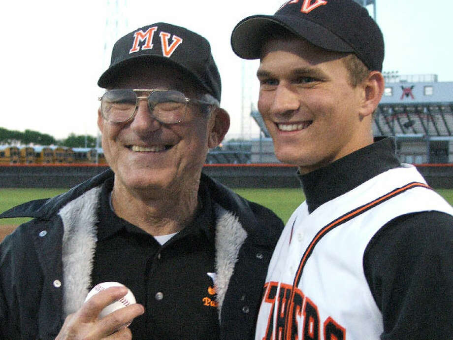 Willie Kempf poses with his grandfather Gerald during his playing days at Medina Valley High School in 2006.