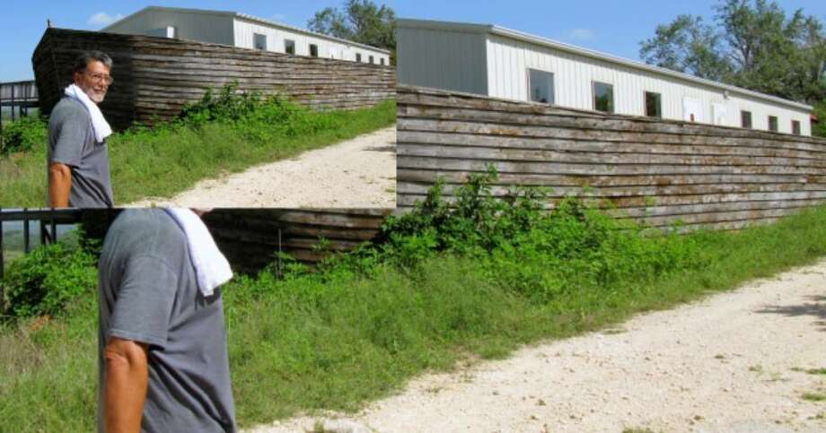 Alfonse Salazar or San Antonio passes the Ark-shaped school on the grounds of the former Christ of the Hills Monastery July 17. Salazar bought the property in January and is in the process of cleaning out trash left behind and demolishing most of the buildings.