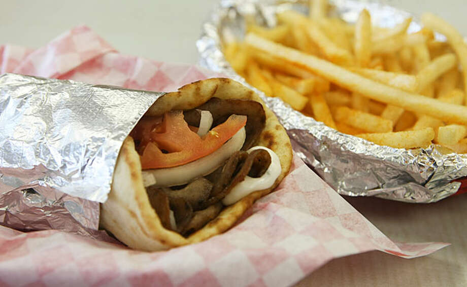 The gyro is a delicious mixture of sliced lamb and beef, sliced onions and tomatoes and a yogurt-cucumber mix in a pita. / SAN ANTONIO EXPRESS-NEWS