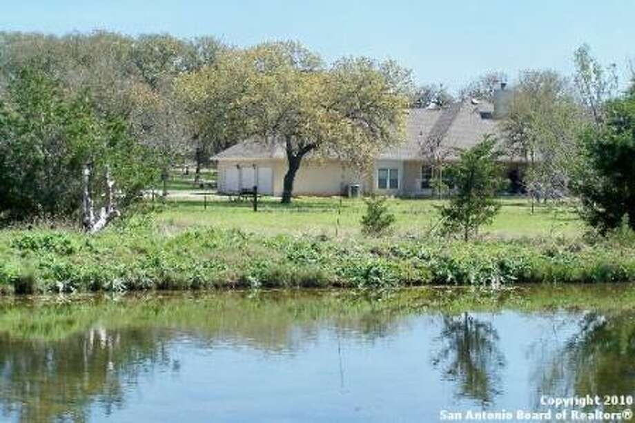 The 11-year-old, three-bedroom, three-bath home is on 5.2 acres in the Rim Rock Ranch subdivision in Bulverde.