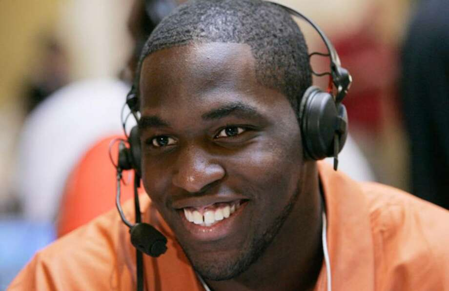 Senior Sam Acho speaks with reporters Wednesday at Big 12 media days in Irving.
