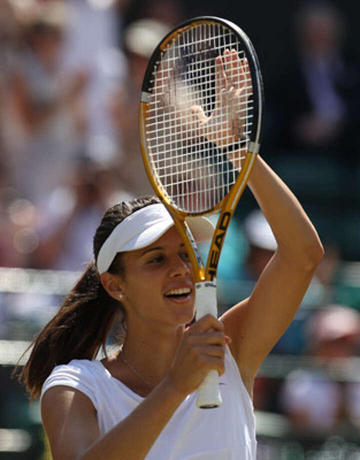 Bulgaria?s Tsvetana Pironkova celebrates after her stunning 6-2, 6-3 victory over Venus Williams.