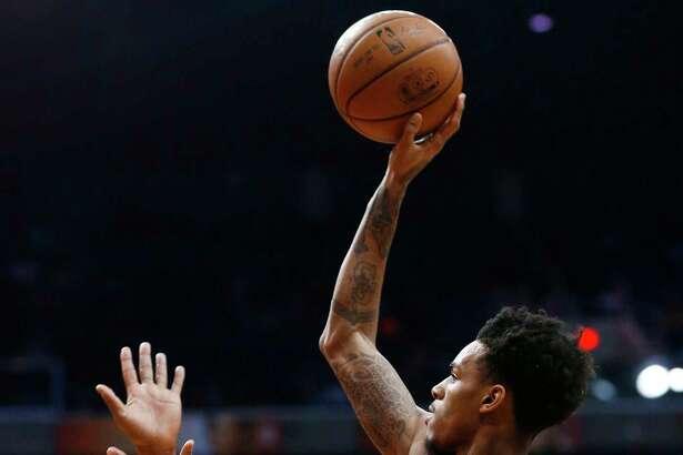 San Antonio Spurs forward LaMarcus Aldridge (12) dunks over Phoenix Suns' Jared Dudley, right, during the first half of an NBA basketball game Saturday, Dec. 9, 2017, in Phoenix. (AP Photo/Ralph Freso)