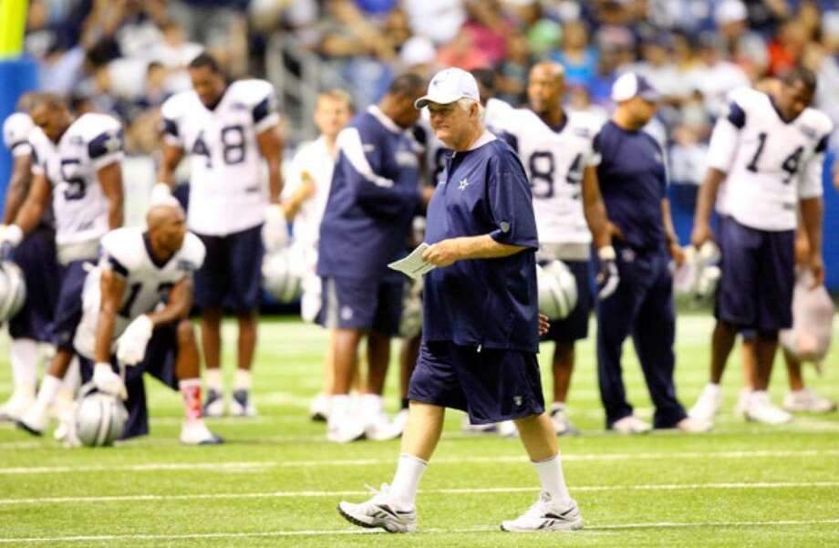 Cowboys coach Wade Phillips walks the field during Sunday's afternoon practice at the Alamodome. It was the first of 12 two-a-day practice sessions the team will hold during training camp.