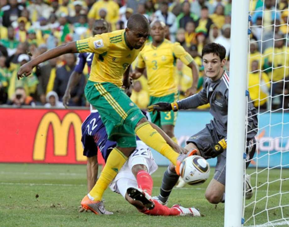 South Africa's Katlego Mphela scores his team's second goal against France goalkeeper Hugo Lloris (right) in their Group A match on Tuesday in Bloemfontein, South Africa.