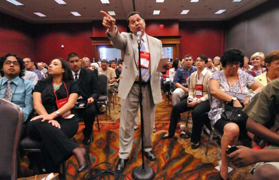 Ricardo Romero of Lorain, Ohio, stresses a point during the question and answer portion of a National Council of La Raza seminar regarding Arizona's new immigration law.