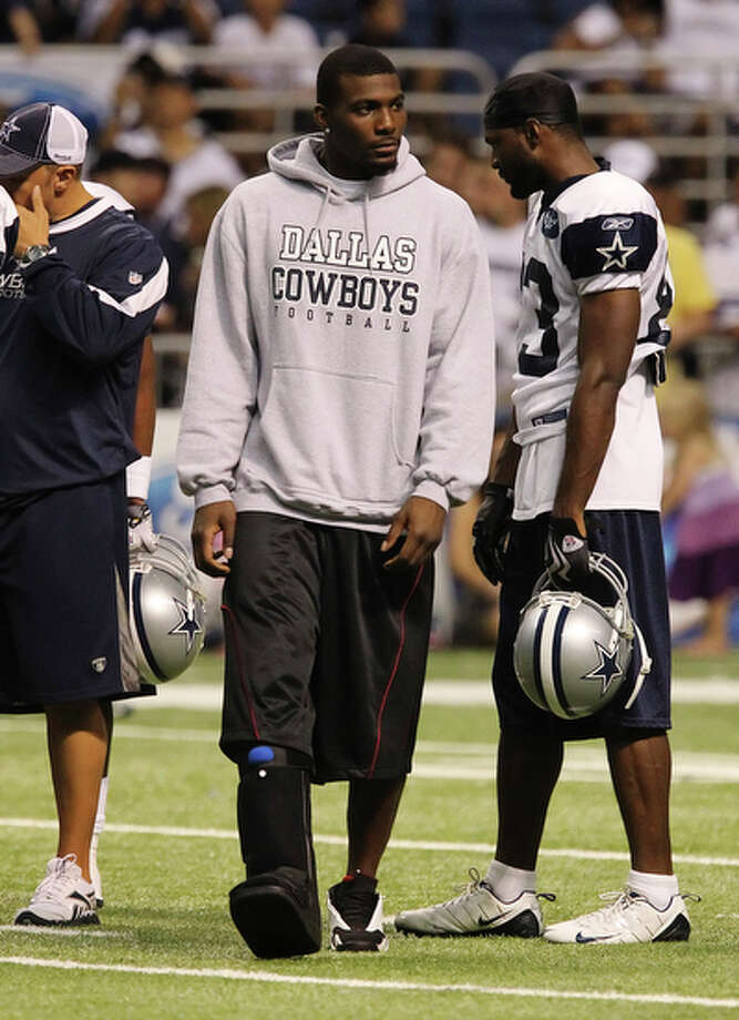 Injured receiver Dez Bryant appears at the afternoon practice session at the Dallas Cowboys training camp at the Alamodome on Saturday, July 31, 2010. Bryant was not suited in pads but was wearing a black boot for his sprained right ankle. He is expected to be out of action for four to six weeks. Kin Man Hui/kmhui@express-news.net / San Antonio Express-News