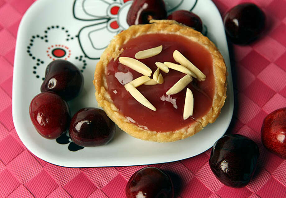 Cherry Tarts are made with Barbados cherries, or acerolas as they are known in Puerto Rico, and topped with almond slivers.