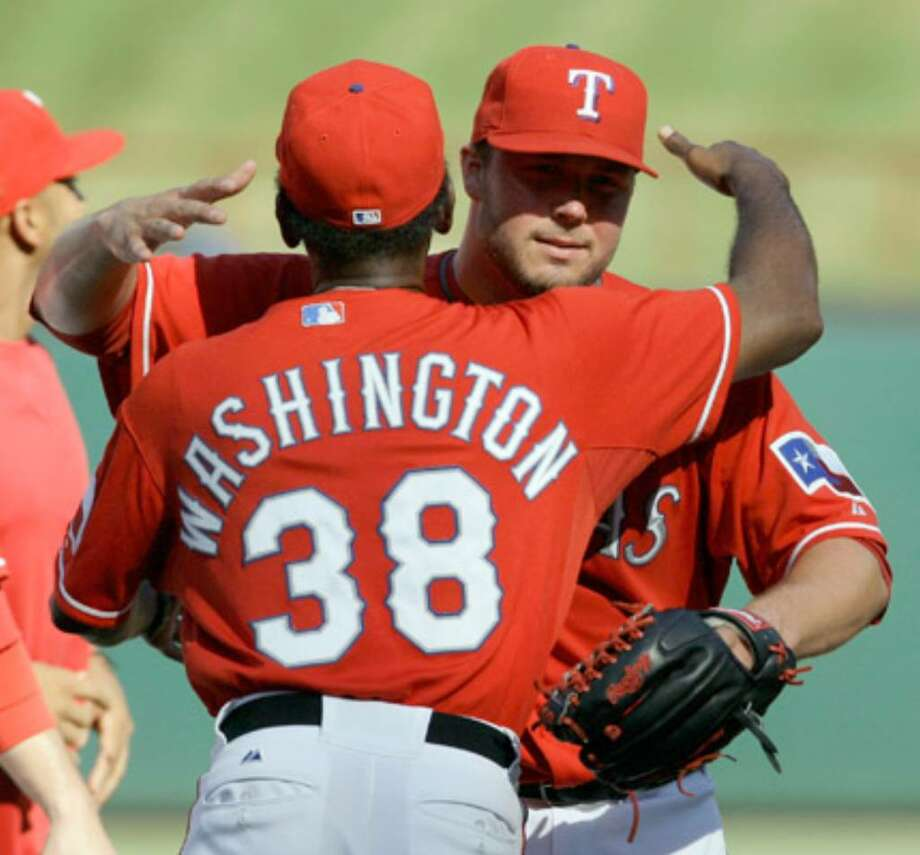Rangers pitcher Tommy Hunter (right) gets a hug from manager Ron Washington following a complete-game victory against the Rays.
