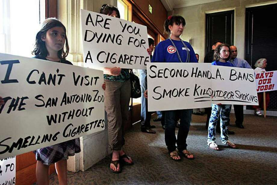 Supporters of a new smoking ordinance attend a City Council public debate at City Hall on Aug. 19.
