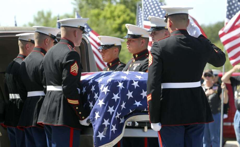 The casket is carried into the funeral for Marine Cpl. Jacob Leicht at the Impact Christian Fellowship Church in Kerrville.