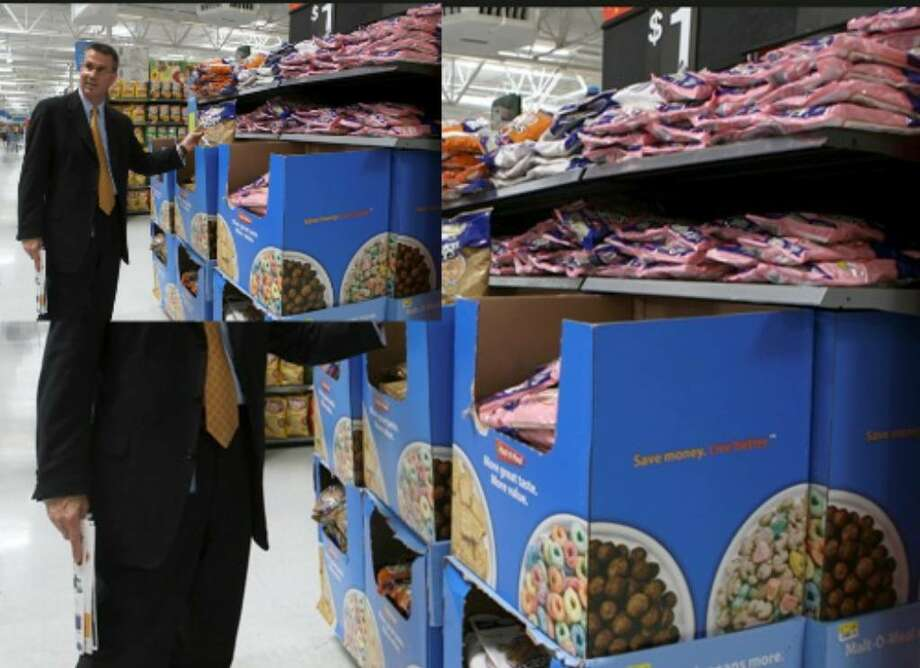 Jeff McAllister, senior vice president for Texas' Wal-Mart stores, tours Wal-Mart's Austin Highway store on Tuesday.