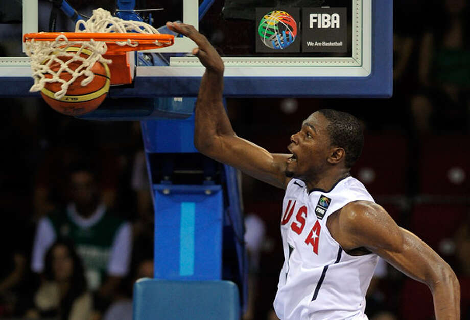 Kevin Durant dunks for two of his 27 points during the Americans' 70-68 victory over Brazil on Monday in Istanbul.