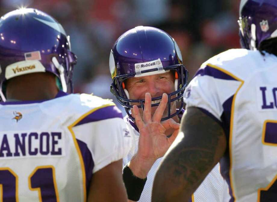 Minnesota Vikings quarterback Brett Favre signals in the huddle during his first action since returning to the team. The 40-year-old veteran was in on only four plays of the Vikings' 15-10 preseason loss to the San Francisco 49ers on Sunday night.