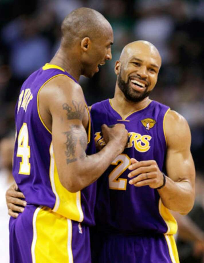 Kobe Bryant (left) and Derek Fisher celebrate in the fourth quarter of Tuesday's Game 3.