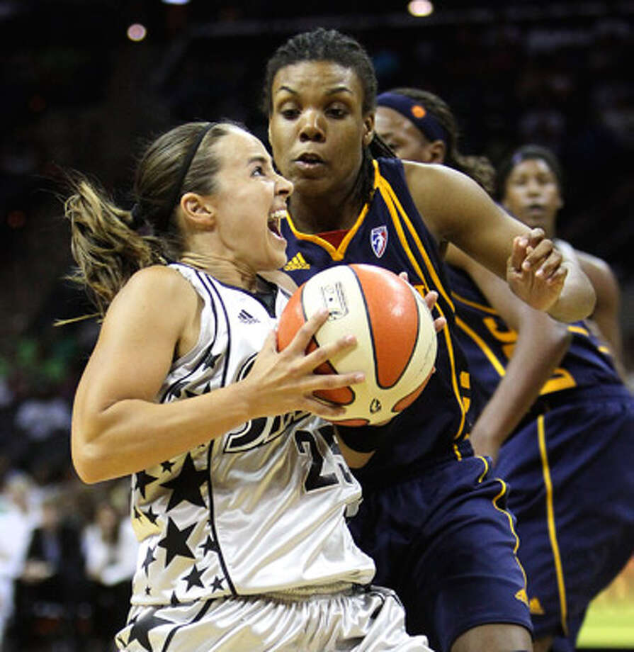 Silver Stars guard Becky Hammon (25) drives past the Sun?s Tan White during Tuesday?s victory.