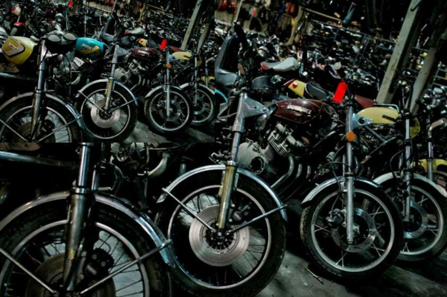 Motorcycles are lined up for Saturday's sale at Action Cycle Warehouse, soon to be called Longhorn Cycles.