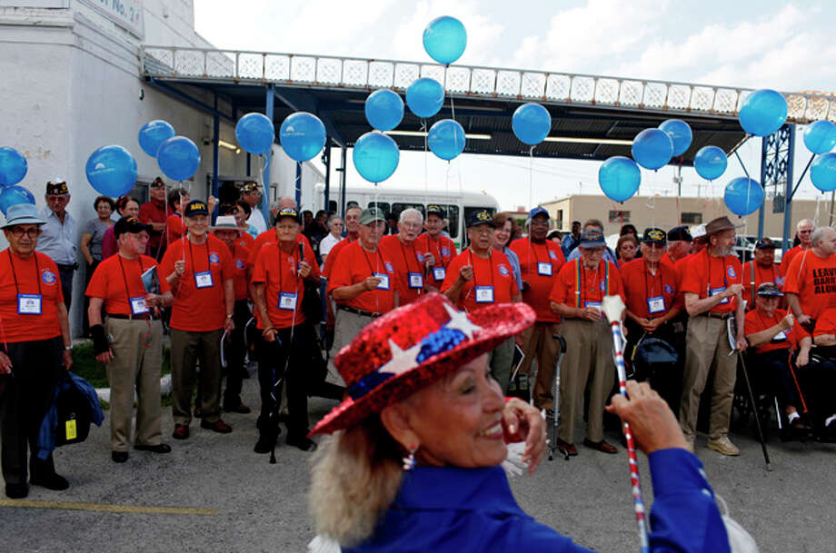 Sylvia Herrera performs with the San Antonio Marching Band as they send off 30 World War II Veterans for the inaugural Alamo Honor Flight at American Legion Post 2 on Friday, August 13, 2010. / SAN ANTONIO EXPRESS-NEWS