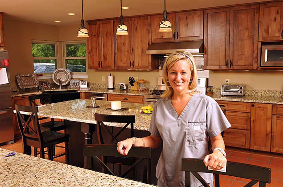 Jenna Hooper says the renovation doubled the size of the kitchen in her 1960s-era Leon Springs house. / Copyright 2010 by Robin Jerstad, Jerstad Photographics LLC-All Rights Reserved-www.JerstadPhoto.com