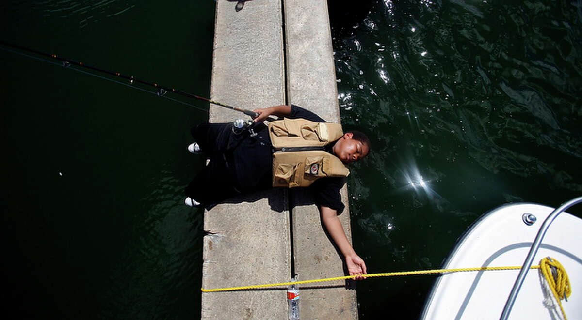 Sha'Quille Cottrell, 14, takes a moment to relax after fishing for hours and not being able to catch anything.
