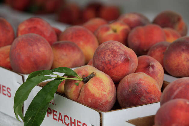Peaches for sale at the Donald Echkardt Orchards stand. / glara@express-news.net