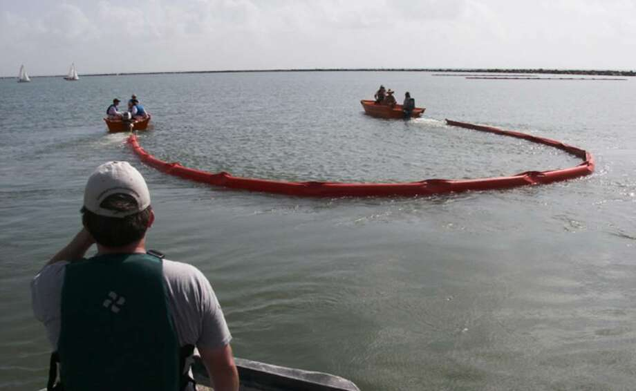 The hands-on training at the National Spill Control School at Texas A&M University-Corpus Christi includes driving boats, deploying oil booms, and working skimmers.