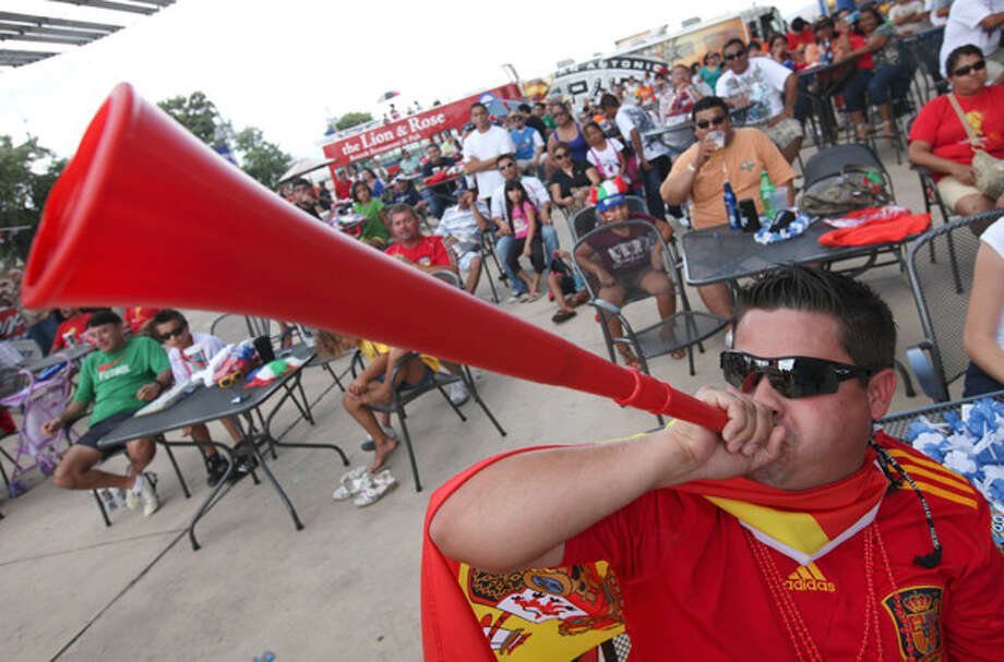Spain fan Hector Torres, 22, blows a vuvuzela while watching the World Cup final between Spain and the Netherlands Sunday at the AT&T Center.