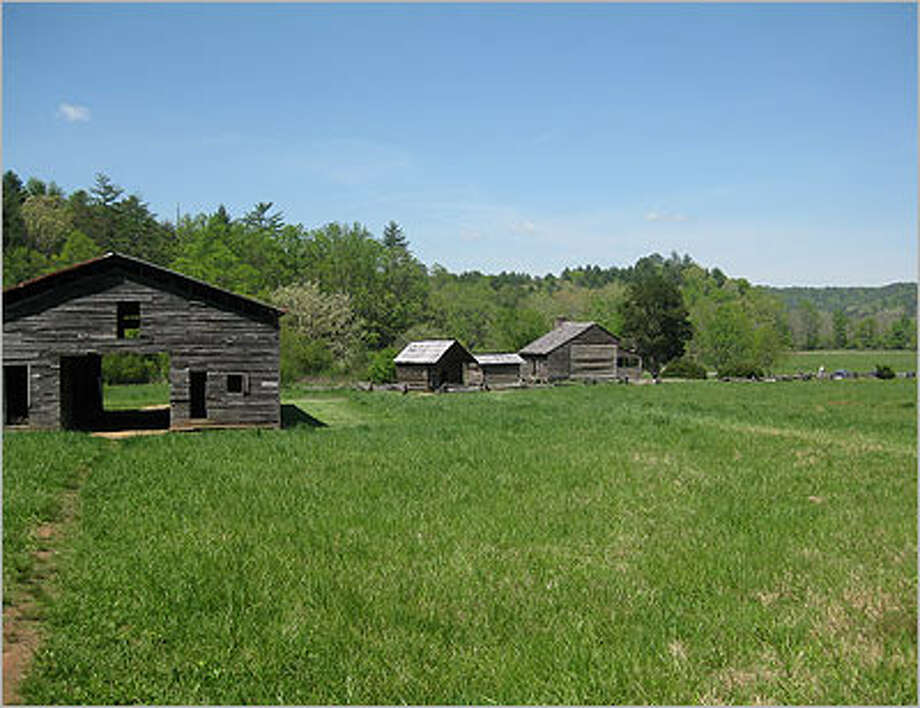 The Dan Lawson Place is Site No. 15 on the Cades Cove loop. The hours was built in 1856. The small building closest to the house is a granary, and the other is a smokehouse.