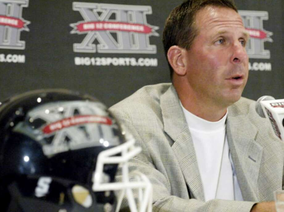 Nebraska coach Bo Pelini answers questions during the Big 12 Football Media Day in Irving. He tried to downplay the hype surrounding the Oct. 16 meeting with Texas and said he wasn't happy about a school- produced video focusing on the game.