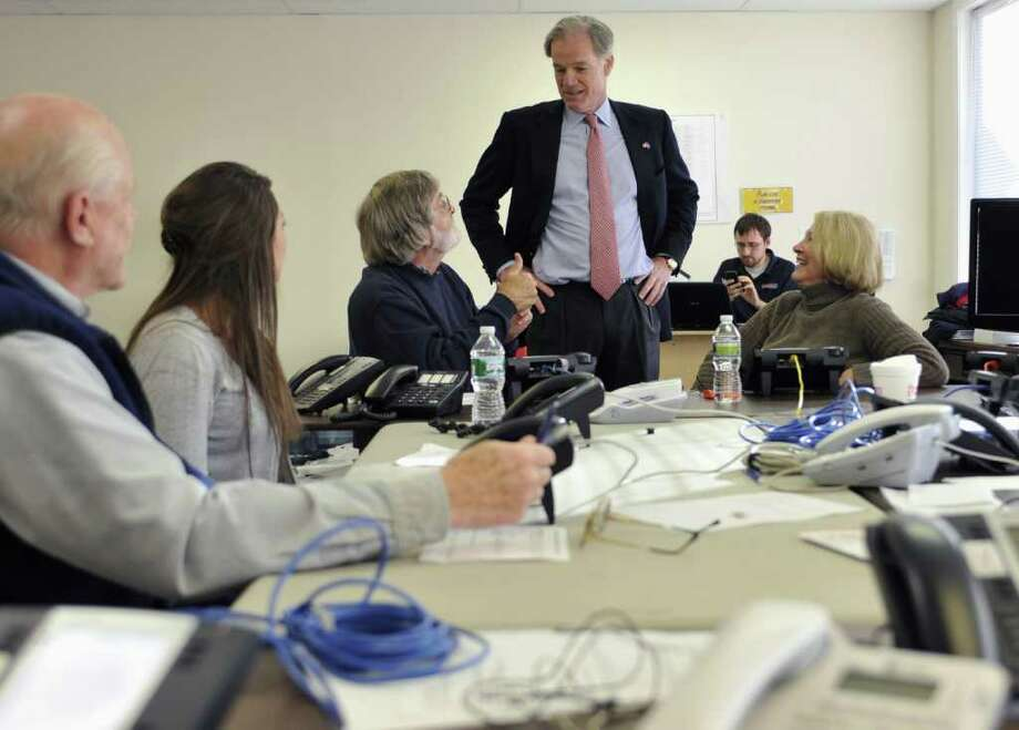 Republican candidate for governor Tom Foley, standing, talks to phone bank volunteers in West Hartford, Conn., Monday, Nov. 1, 2010. Foley faces Democrat Dan Malloy in the Nov. 2 election. (AP Photo/Jessica Hill) Photo: Jessica Hill, AP / AP2010