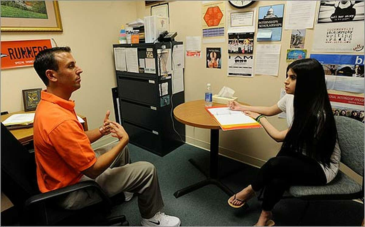 Amanda Nevarez, 23, who will soon graduate, seeks advice from Mike Zucker, a career center counselor at UTSA.