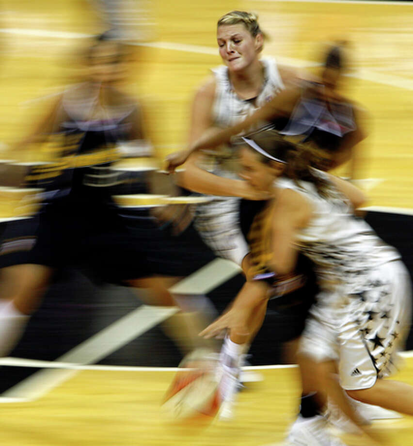 San Antonio Silver Stars center Michelle Snow, 2, tries to bring down a rebound against Tulsa Shock forward on Friday, July 16, 2010 at the AT&T Center. Tulsa defeated San Antonio 75-70.