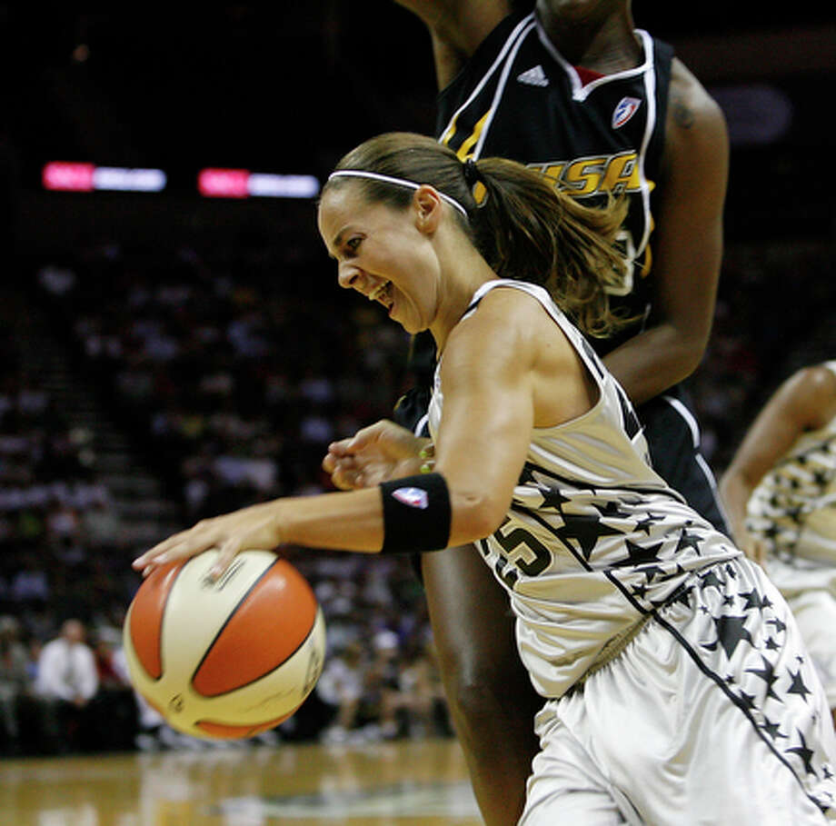 Guard Becky Hammon, 25, tries to dribble around Tulsa Shock forward Tiffany Jackson, 33.